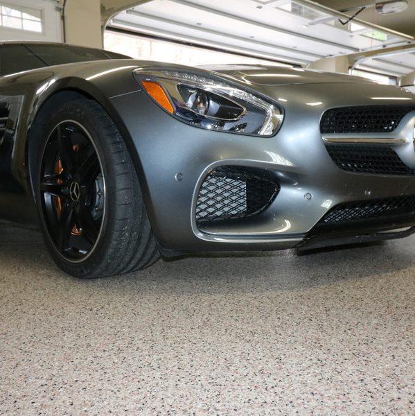 epoxy flooring under a grey car