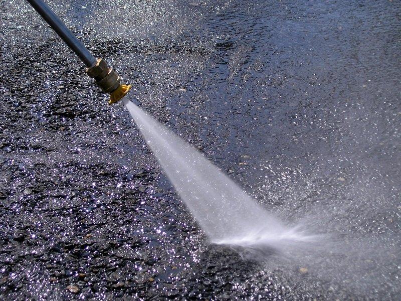 concrete floor being power wash