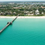turquoise colored beach in naples city, florida