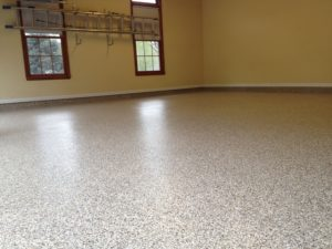 garage with shiny epoxy flooring in tampa